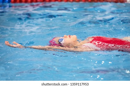 little girl swimming in the pool at the training in swimming