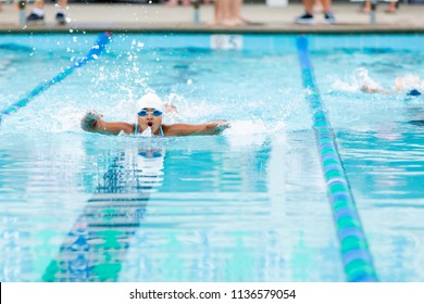 Little Girl Swimming Really Fast at a Swim Meet Competition