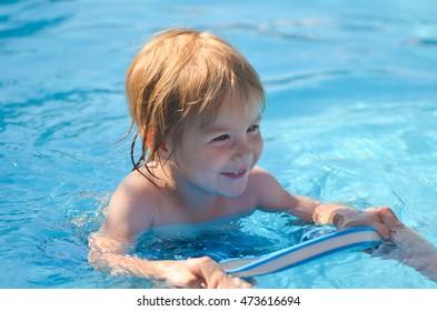 little girl swims