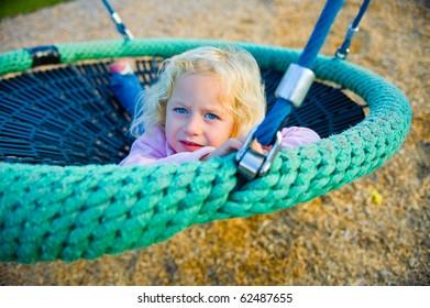 little girl in a swing