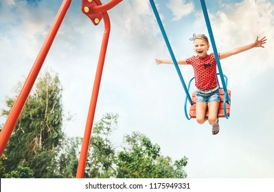 Little girl swing on swing