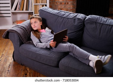 Little girl with tablet pc at home