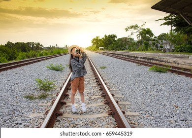 little girl taking photos by digital camera