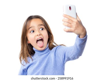 Little girl taking a selfie photo with a smart phone