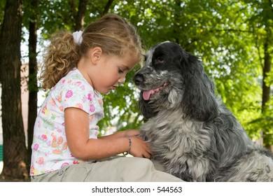 little girl talking to her dog