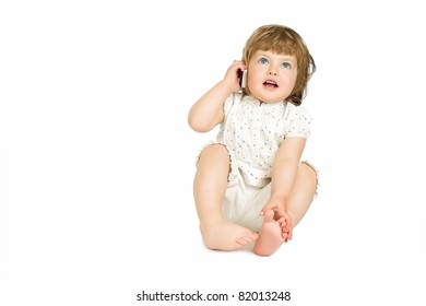 Little girl talking on a mobile phone