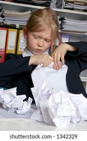 Little girl tearing documents