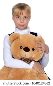 Little girl with a teddy bear. The concept of the game, raising a child in kindergarten and in the family. Isolated on white background.