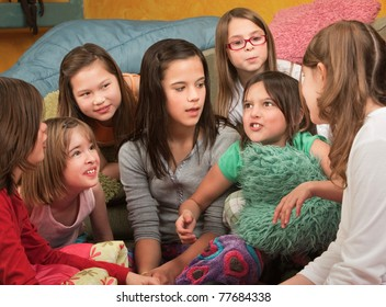 Little girl tells a story at a sleepover