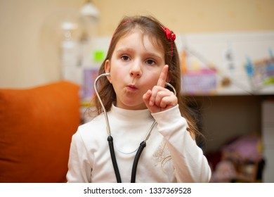 The little girl is thinking about the diagnostic like a doctor.