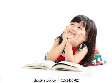little girl thinking or dreaming during preparing homework