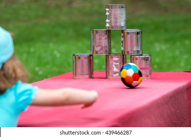 Little girl throws a ball for children's party