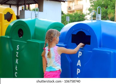 little girl throws paper waste into special recycling trash bin