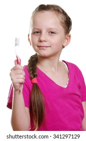 little girl with toothbrush on white