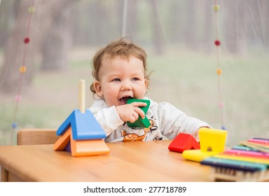 Little Girl with Toys, wooden xylophone