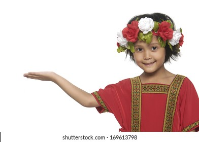 Little girl in traditional dress holding an open palm empty hand