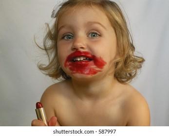 little girl trying on lipstick 3