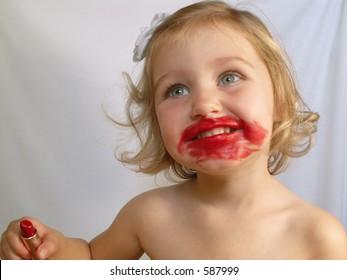 little girl trying on lipstick 5