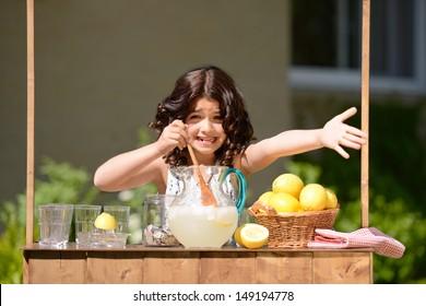 little girl trying to sell lemonade