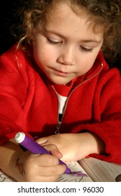 little girl trying to write - focus on the hands