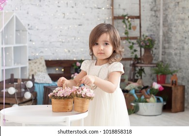 little girl with two baskets of flower