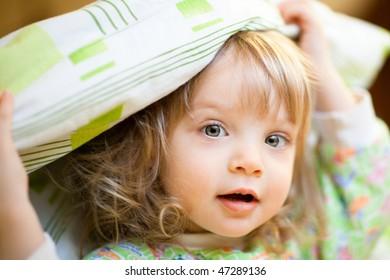 Little girl under the blanket - shallow DOF, focus on front eye