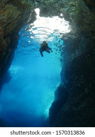 little girl underwater in cave and cavern enjoying the sea ocean