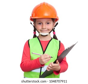 little girl in uniform and helmet holds a tablet and a pen, and imagines herself an industrial worker