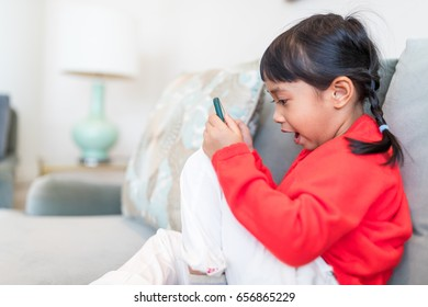 Little girl use of cellphone at home