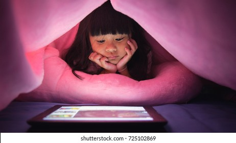Little girl uses a tablet