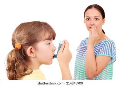 little girl using inhaler due to smoke