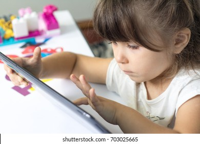 Little girl using Tablet PC at home or kindergarden. Education, science, technology, children and people concept