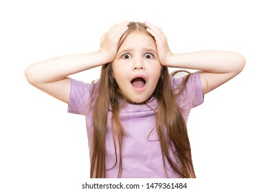 The little girl is very surprised, clutching her head. Isolated on a white background