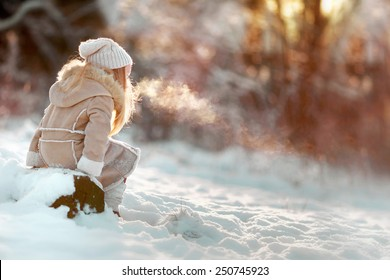 little girl in the village in winter