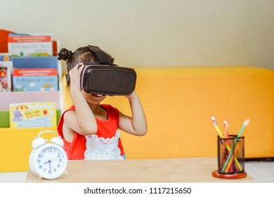 little girl with virtual reality glasses. Innovation technology and education concept