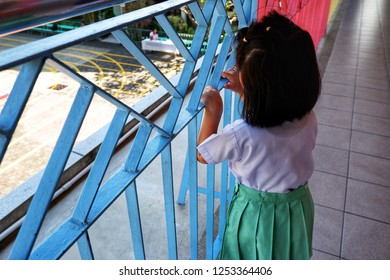 Little girl waiting for her mother to pick up home