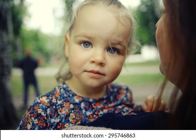 little girl for a walk in the park