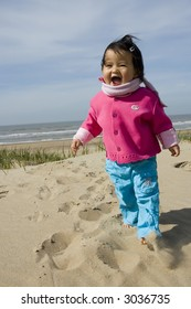 little girl walking at the beach