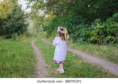 Little girl walks on a path