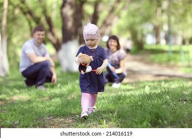 little girl walks in the park in summer