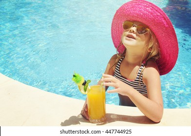 Little girl in watter pool in the summer day