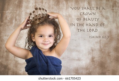 Little girl wearing crown with Bible verse on grunge background