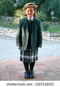 Little girl wearing a generic winter school uniform, first day of school