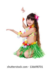 Little girl wearing Hawaiian dress sitting on the floor holding the blank board isolated on white