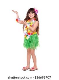 Little girl wearing Hawaiian dress dancing isolated on white