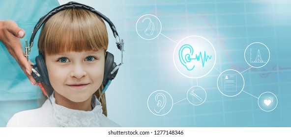 little girl wearing headphones while audiometry test with hearing icons on background