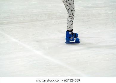 little girl wearing leging, jeans on ice rink - Ice skating little girl.