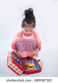little girl wearing pink native dress on white background