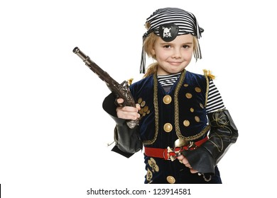 Little girl wearing pirate costume holding a gun, over white background
