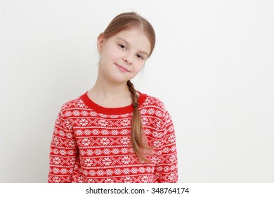 little girl wearing red sweater on Christmas
